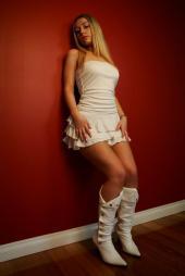 Melissa Leonard - White dress against wall