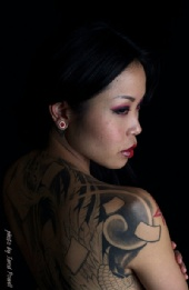 Kelsy Nakamatsu - Partial view of side tattoo
