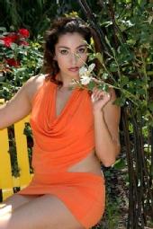 Elisia Jaramillo - Smelling white flower