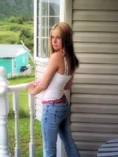 Dee - standing on a balcony